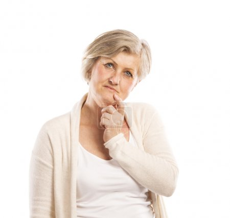 Photo for Portrait of a happy senior woman thinking, isolated on a white backgroun - Royalty Free Image