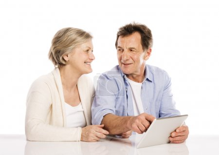Photo for Senior couple using tablet, isolated on white background - Royalty Free Image