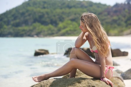 Woman relaxing at the beach.