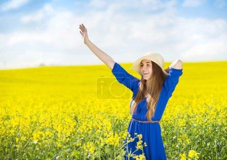 Girl in colza field