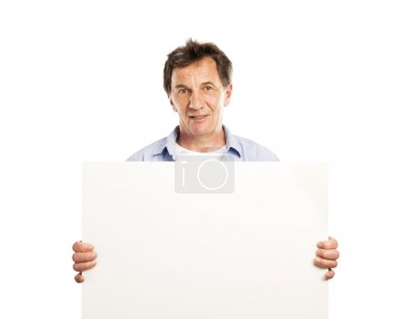 Photo for Portrait of happy senior man with blank advertising board or copy space, isolated on white - Royalty Free Image