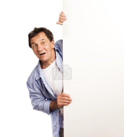Senior man with advertising board