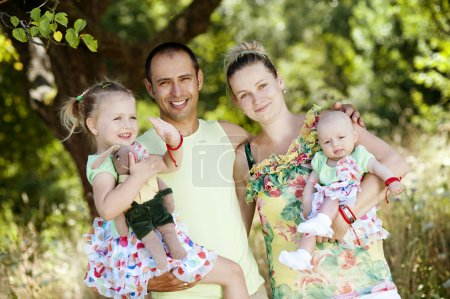 Photo for Happy young family spending time together in green nature - Royalty Free Image