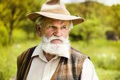 Old farmer in hat