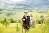 Farmer walking in meadow