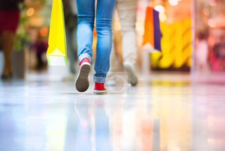 Photo for Closeup view of woman's legs with colorful papers bags in shopping mall - Royalty Free Image