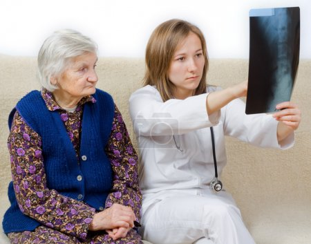 Young doctor tells the diagnosis to the old woman