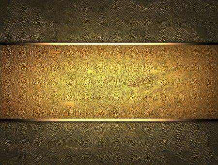 Foto de La plantilla para la inscripción. hermoso fondo de oro con una placa de oro para la escritura. - Imagen libre de derechos