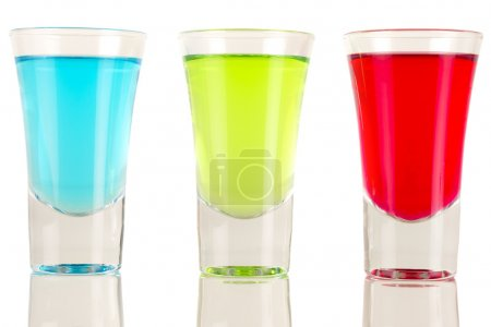 Photo for Shots - Three colourful shot drinks on a white background with reflections - Royalty Free Image