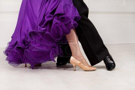Feet partners on the dance floor