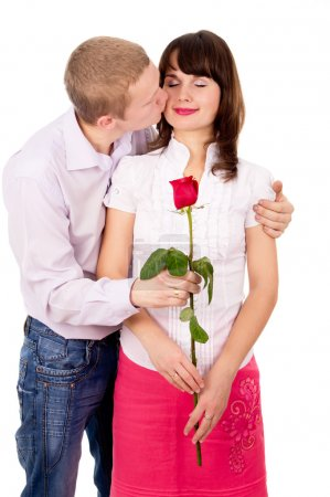 The guy gives a girl a rose, kisses