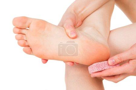 Girl brushing heel, feet