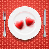 Red hearts on a plate knife and fork vector Eps10 image