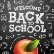 Welcome back to school sale background with red ap...