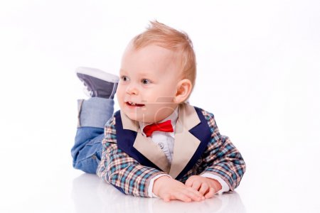 Baby wearing suit on white background
