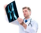 cheerful doctor examining feet x-ray
