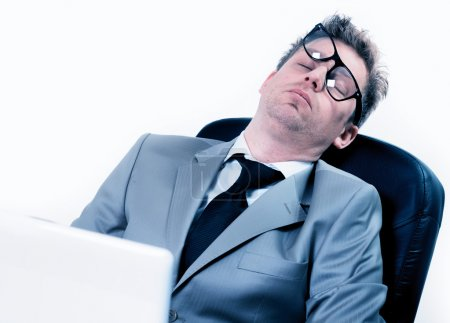 Tired funny businessman at the office