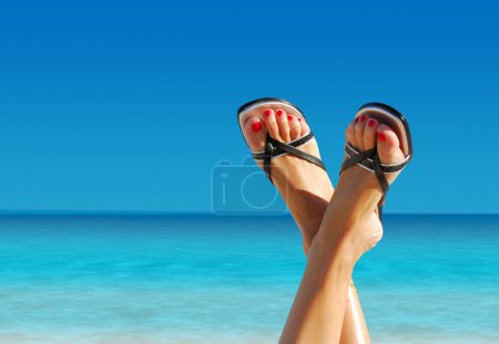 Photo for Nice feet crossed on an island paradise - Royalty Free Image