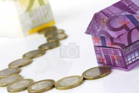 Euro bank notes House and coins