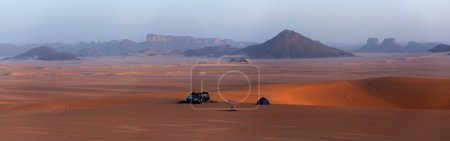 Parked car in the Sahara Desert
