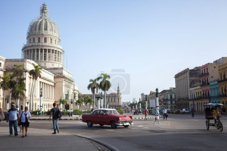 HAVANA,CUBA - JUNE 21: Street scene with cuban people and colorful old buildings