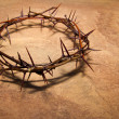 Crown of thorns over brown marble background, copy...