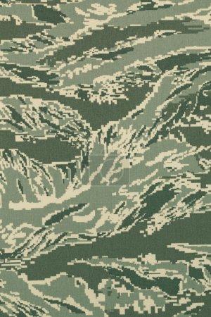 Green digital tigerstripe camouflage fabric texture background