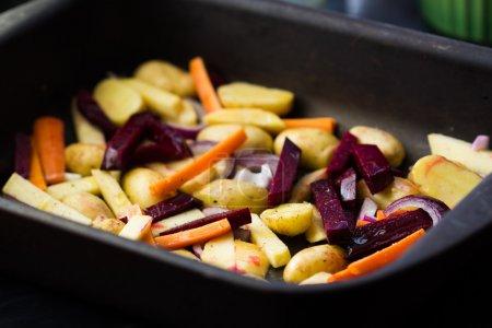 Prepared roots for baking dish, carrots, potatoes, beets, radish