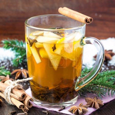 Spicy tea with apple and orange, cinnamon, star anise, Christmas