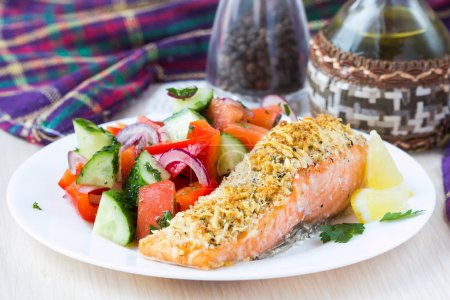 Steak fillet of red fish salmon with cheese crust ...