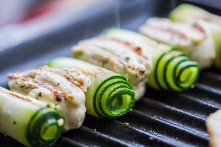 Cooking chicken kebab, shashlik on skewers with rolled zucchini,