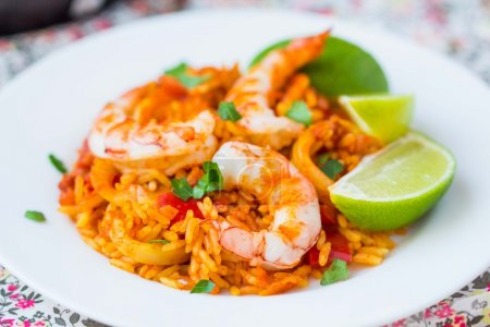 Spanish dish paella with seafood, shrimps, squid, rice, saffron