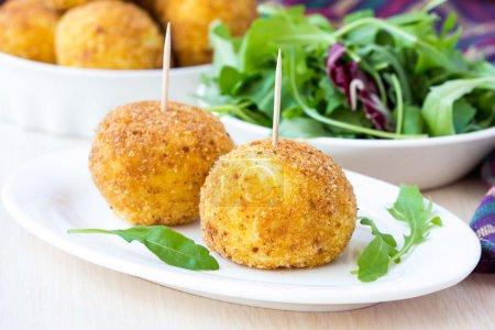 Italian appetizer arancini, rice balls stuffed with meat in oil