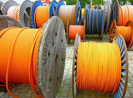 different colours of wires on the wooden spools