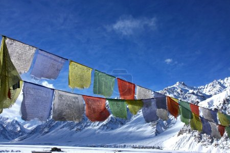 buddhist praying flags in winter himalayas