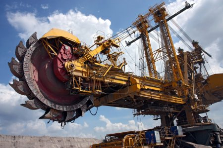 Huge coal mining coal machine under cloudy sky...