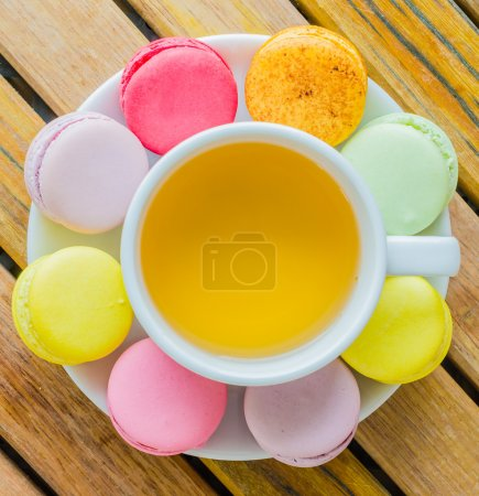 Photo for Colorful macaroon with white cup tea - Royalty Free Image