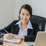 Business women use laptop...
