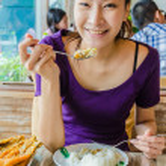 Girl in restuarant in eating action...