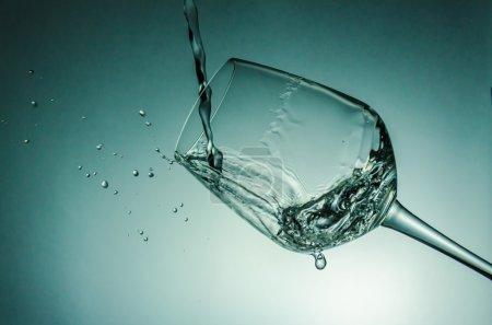 Water splash with wine glass