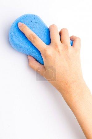 Hand holding sponge on isolated white background
