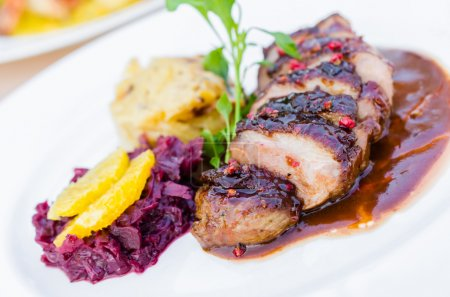 Photo for Duck breast on orange sauce with red cabbage and gratin dauphinoise - Royalty Free Image