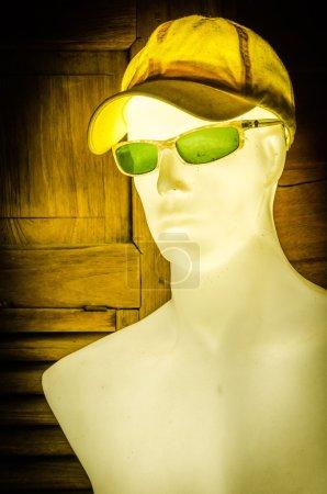 mannequin wear cap and sunglasses