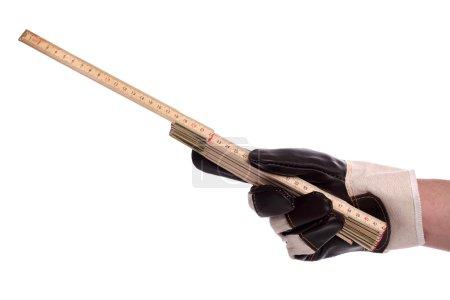 Photo pour Une main avec un bâton de jardin - image libre de droit