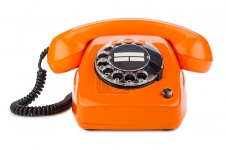 Photo pour Un vieux téléphone orange à cadran rotatif - image libre de droit