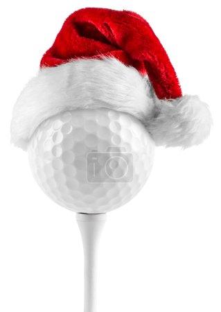 Photo pour Balle de golf sur tee avec Bonnet de Noel - image libre de droit