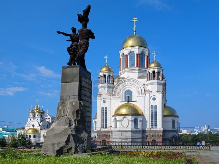 Monument to Komsomol of Ural and churches in Yekaterinburg