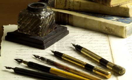 Old ink pot, fountain pens and nibs, old document ...