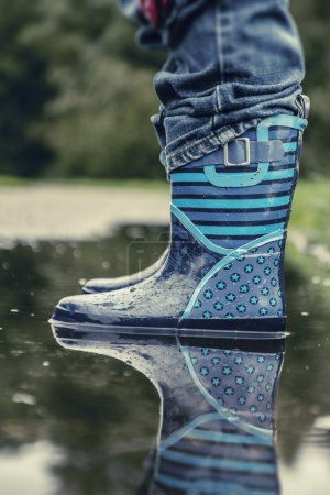 Photo for Little boots on a rainy day. - Royalty Free Image