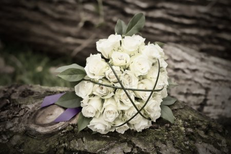 Photo for Bouquet with pretty yellow roses and a purple ribbon - Royalty Free Image